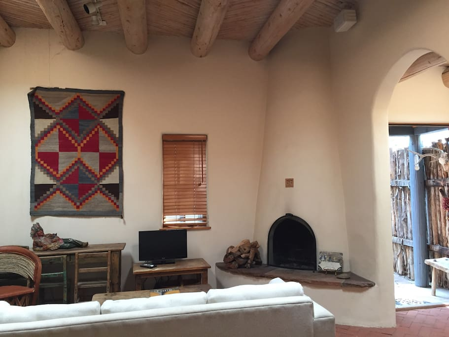 Living room with kiva fireplace.