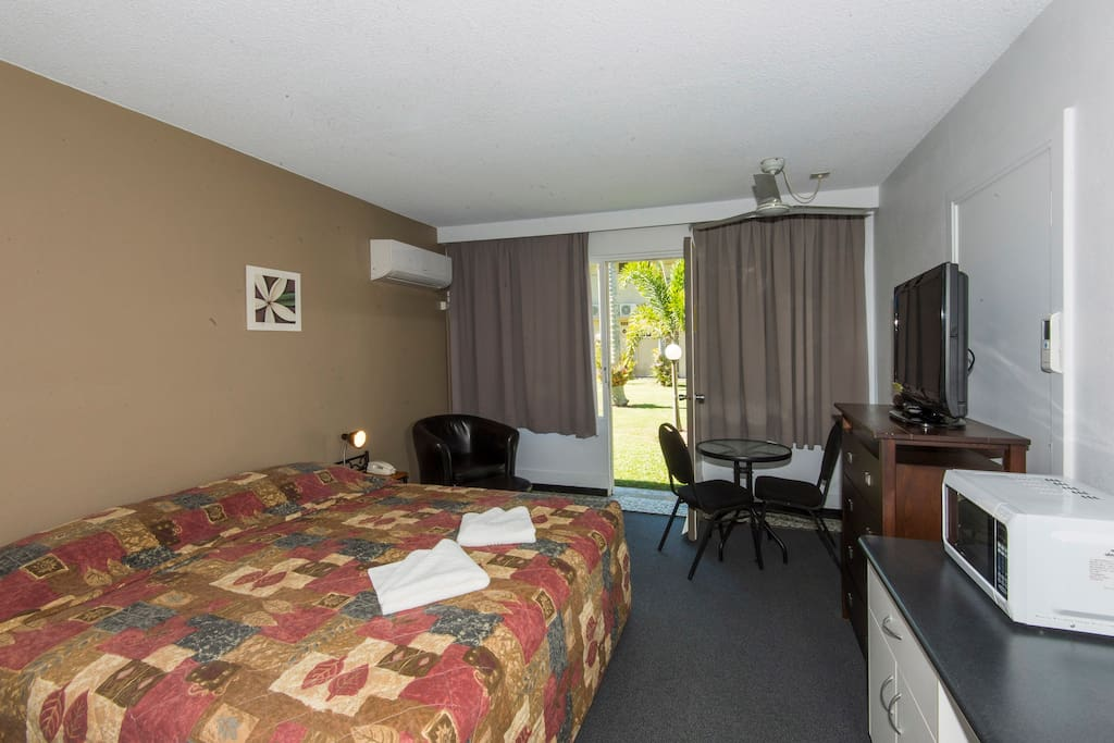 Standard room containing comfortable King size bed.