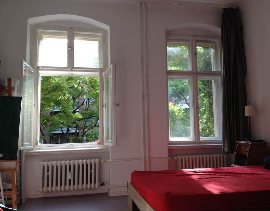 Bright room with big windows on a calm street