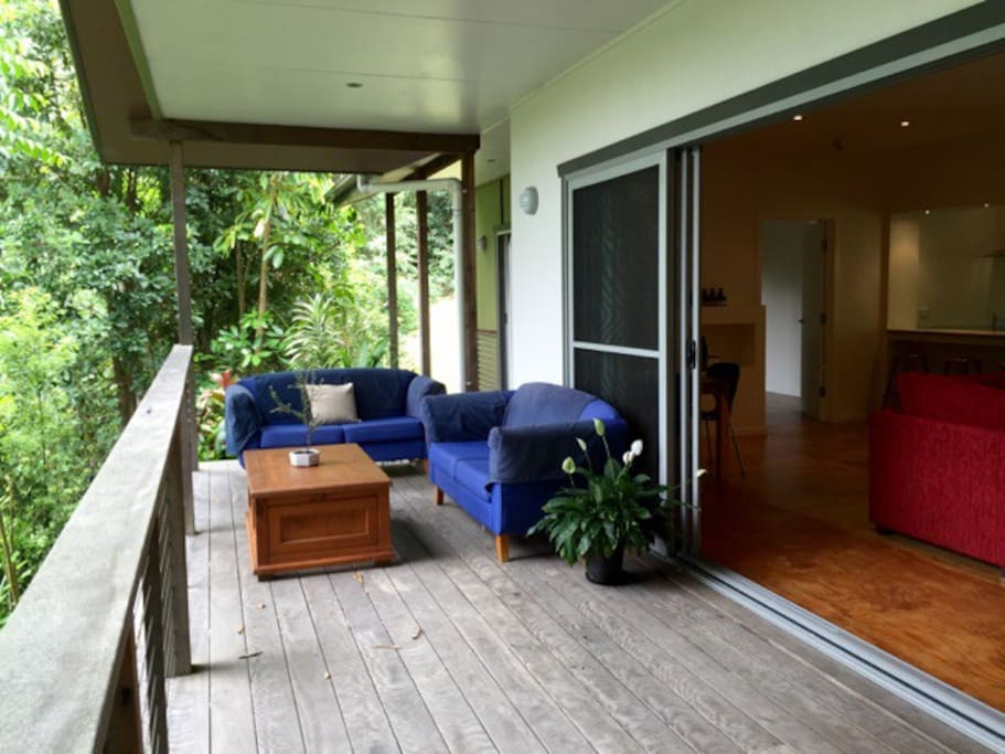 Relax on the private  wrap around deck tucked away next to the nature reserve.