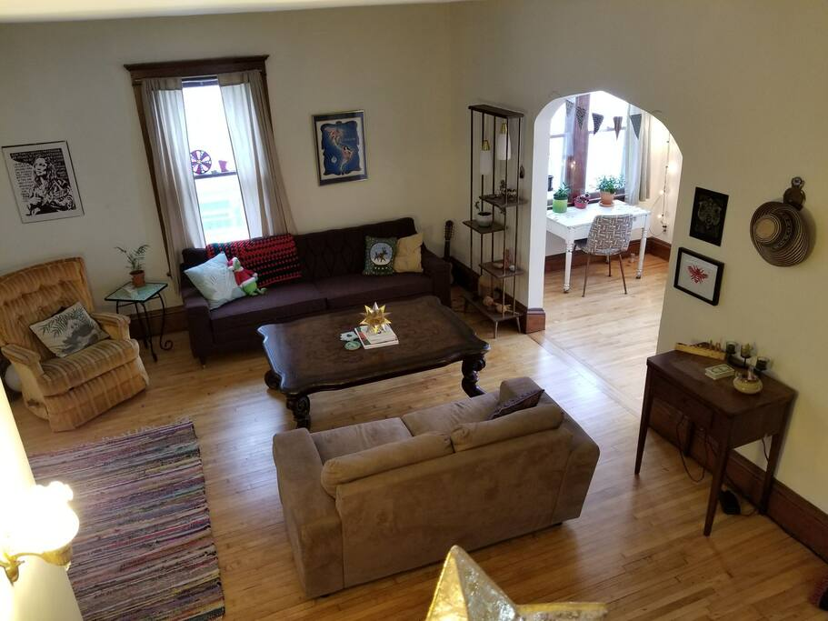 Spacious living room with comfy couches and hardwood floors.
