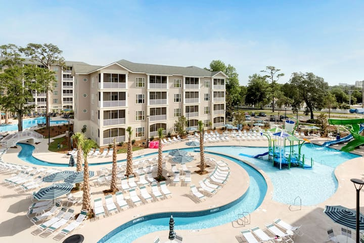 Holiday Inn 2 Minutes From the Beach | Outdoor Pool with Lazy River + Giant Waterslides