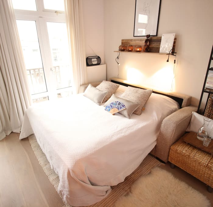 The Airb&B bedroom has a very comfortable bed with an extra king-size mattress on it and blanket & pillows filled with down.