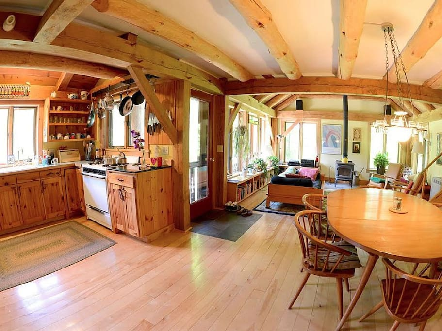 View of Kitchen/Dining Rooms and Living Room in background. Photo by John Finn.