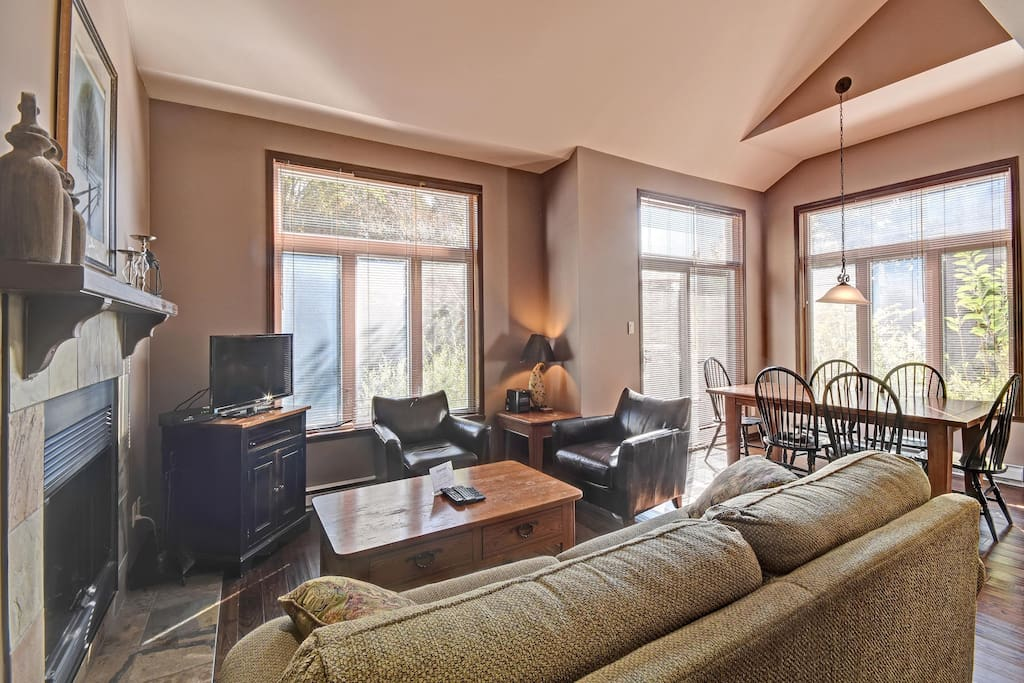 Bright airy family room and dining area with cathedral ceiling