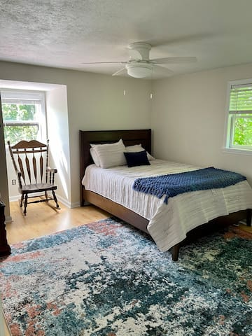 Upstairs bedroom 2 with queen plus air mattress and rocking chair. Excellent Mountain view from window.