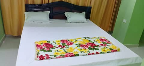 Deluxe bed room with attached bathroom and AC