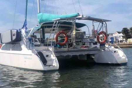 Catamaran sail boat houseboat at luxury resort