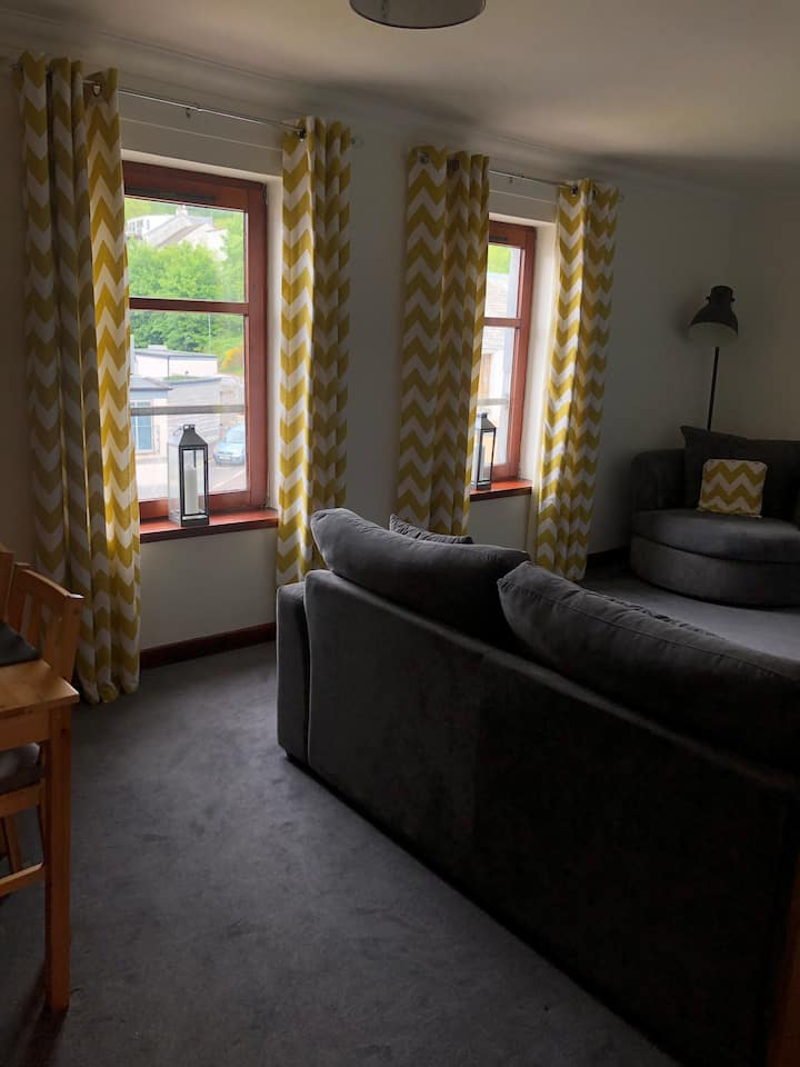 Town centre apartment with private parking.
