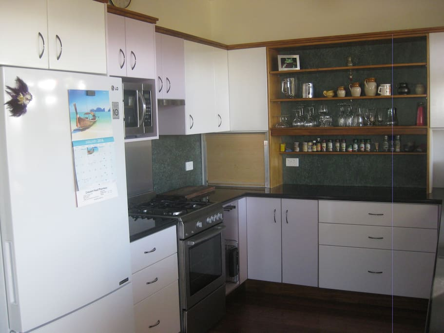 Brand new kitchen; Large Fridge & Freezer, Gas stove &  oven, microwave, double sink.