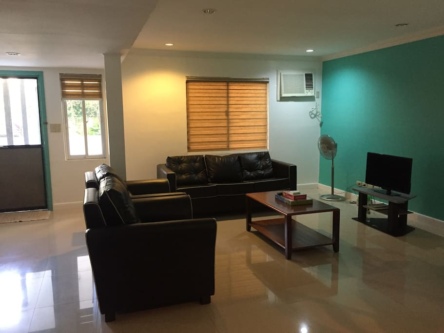 Airconditioned living area with cable tv and a pullout sofa bed.