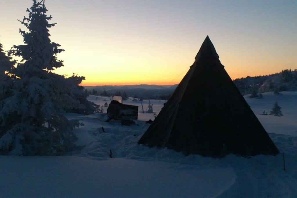 Our lavvu tent in the sunset, kept warm by a fire-oven.