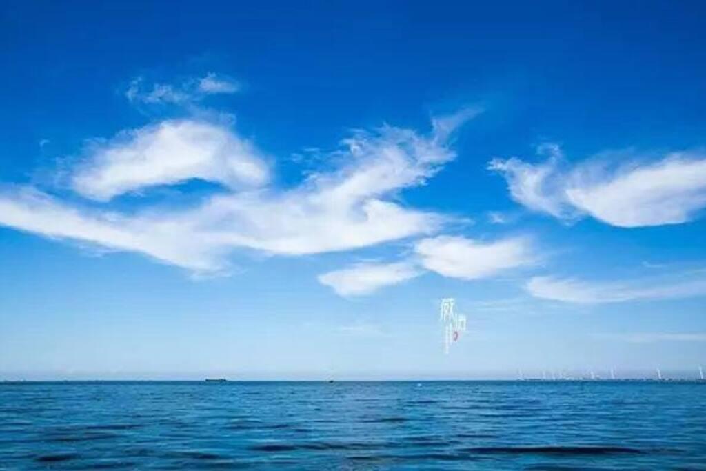 几抹浮云过海漂洋一窗美景赏心悦目