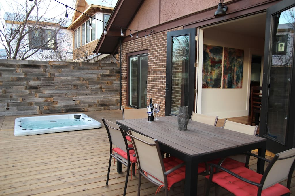 Beautiful indoor-outdoor backyard space with brand new deck and built-in hot tub