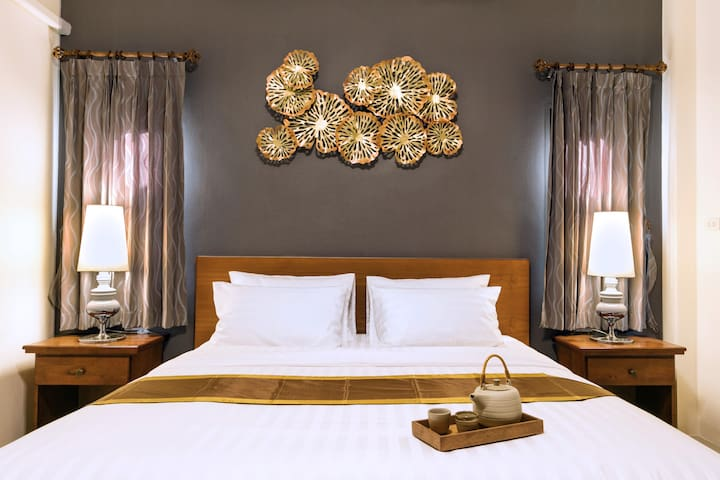 Master Bedroom: Bed Size (WxL) : 6.0x6.5 fts. or 183x198 cm. or 72x78 in. with private bahtroom. Air-con and hair dryer.