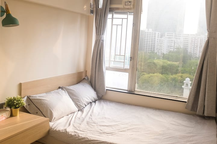 Modern Sunlit Bedroom in TST, Amazing Park View