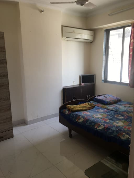 2 beds , aircondioner, wardrobe with long mirror . , and another small cupboard for accessories and a corner table next to the bed and TV with different channels