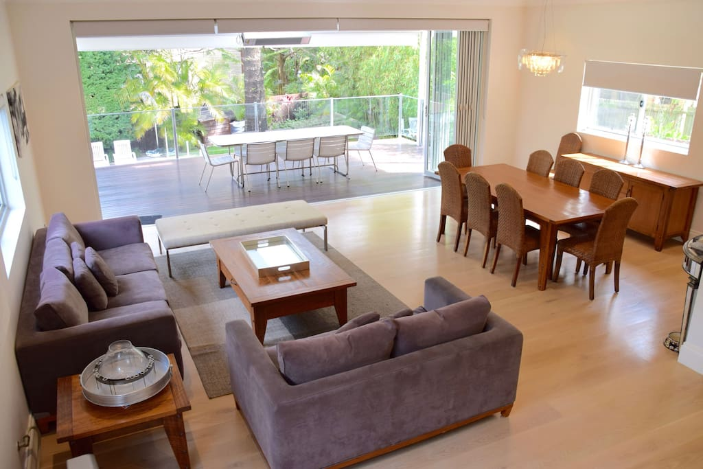 Spacious open plan living and dining area expanding to the entertainment deck.