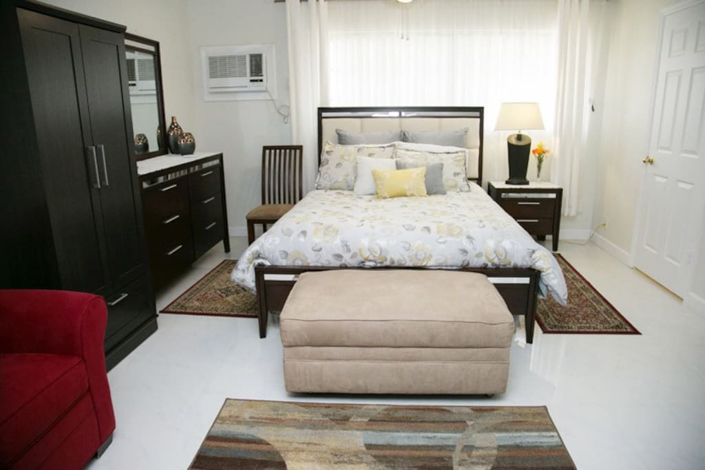 Queen bed and window. The unit has its own wall air conditioner unit. It also has heating. Ceiling Fan is also available.
