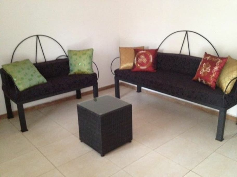 Sitting place with two comfortable handmade sofa's.