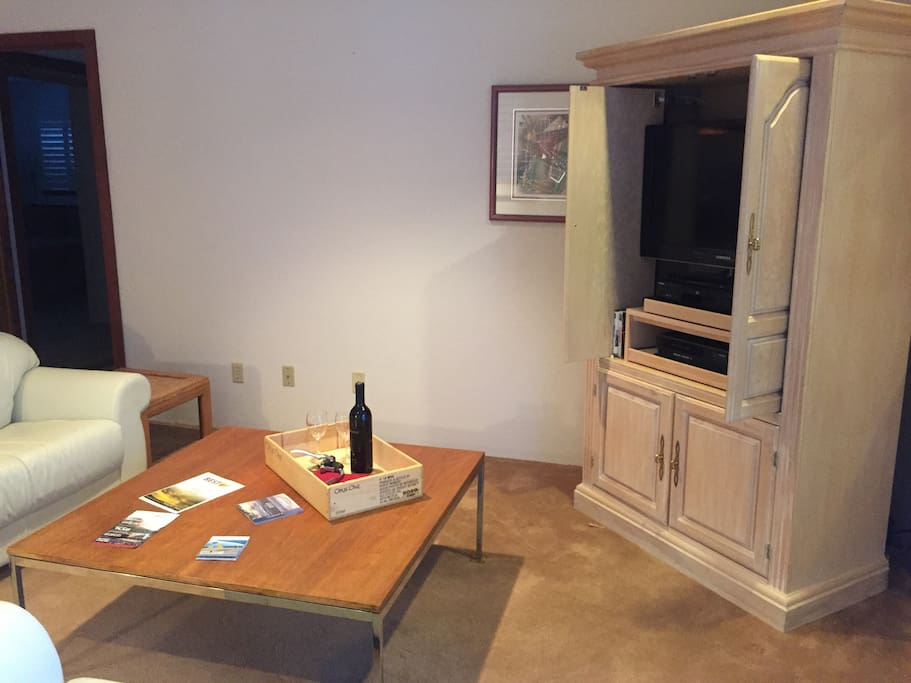 Enjoy wine in the sitting area.  TV with Roku, DVD, & VHS collection.