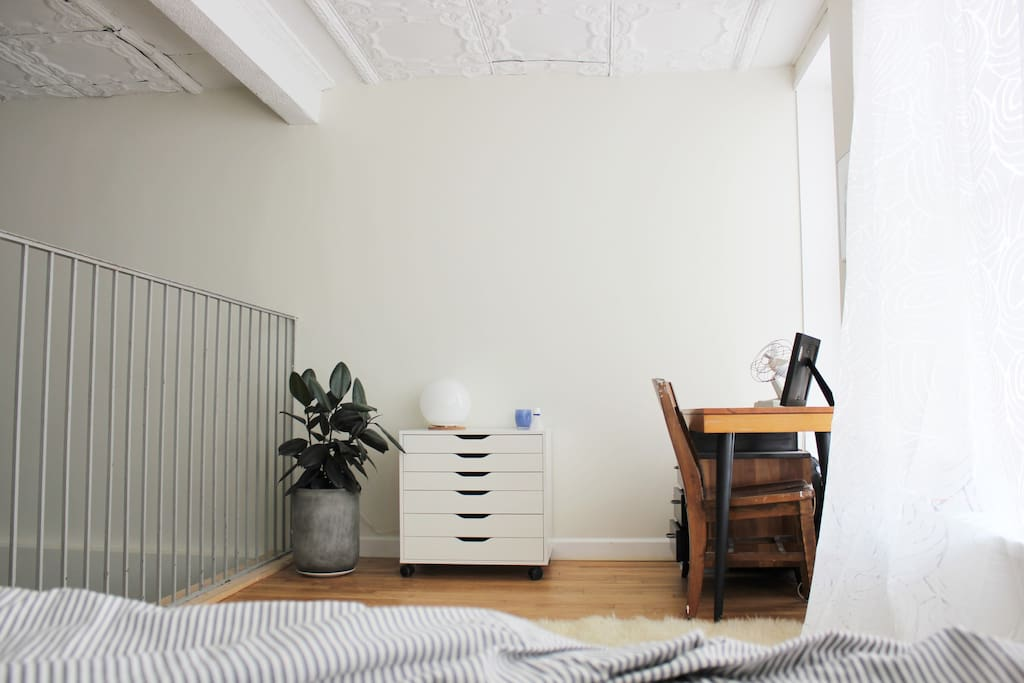 Desk and lamp in loft area.