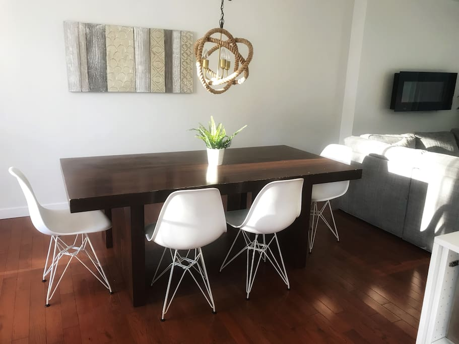 Dining table with new chairs and a bench