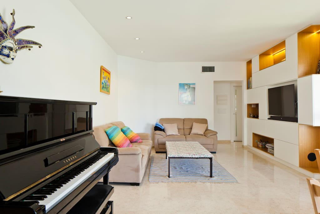 Spacious living room.  Includes two sofas (3+2 seats), table, 48''  HD  smart TV.