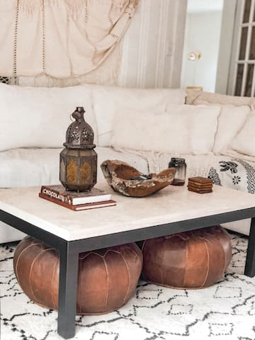 Travertine coffee table and Moroccan lantern (it's just for decoration) leather poofs under the table for foot rests or additional seats.