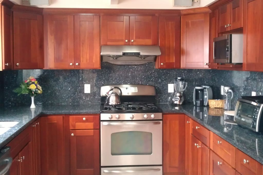New, granite counter-tops, microwave, coffee-maker, pots and glassware, gas stove/oven.