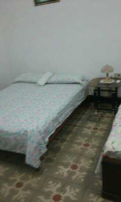 Nuestra Habitacion Mas grande con 2 camas matrimoniales,nevera con bebidas,tv y confort.