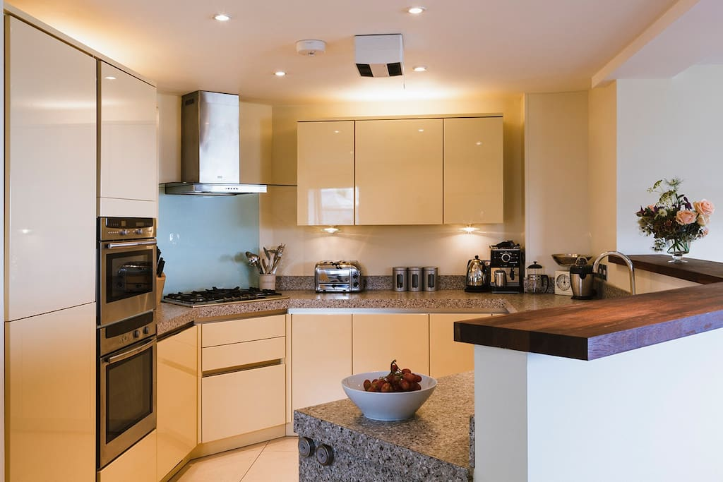 Open plan kitchen, living and dinning area with balcony sea views