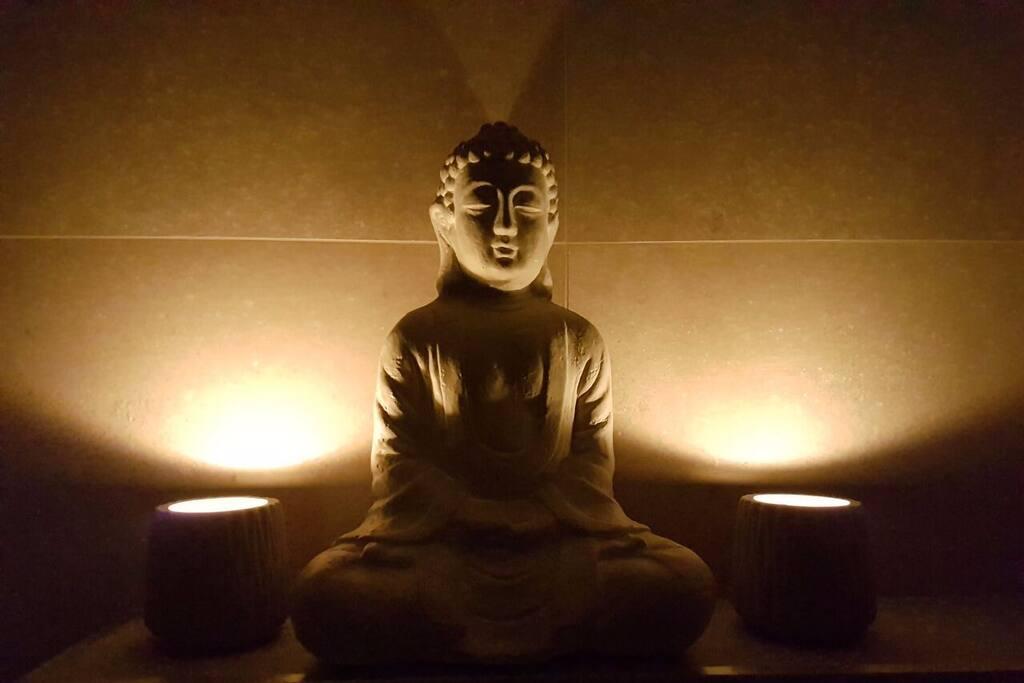 Ancient Buddha in the Bathroom