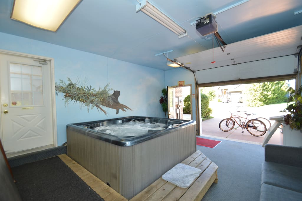 Our 8 man hot tub is located is the garage for all year around use. The garage door can roll up in the summer and winter. Jump from hot tub to snow and back if you dare.