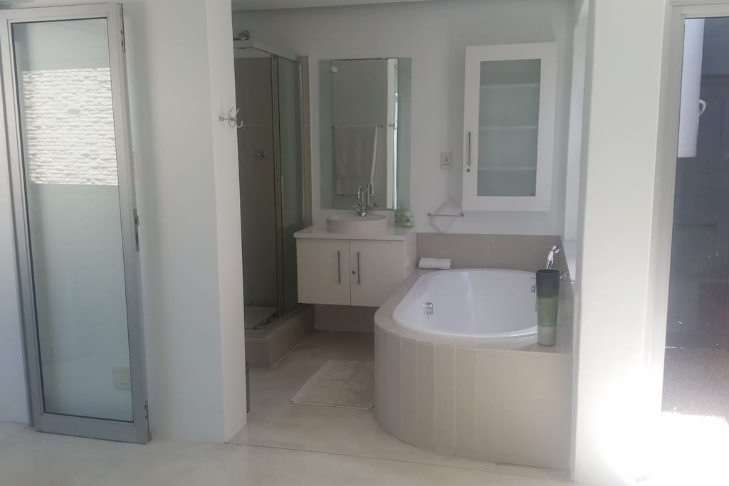 En suite bathroom with bath and separate shower