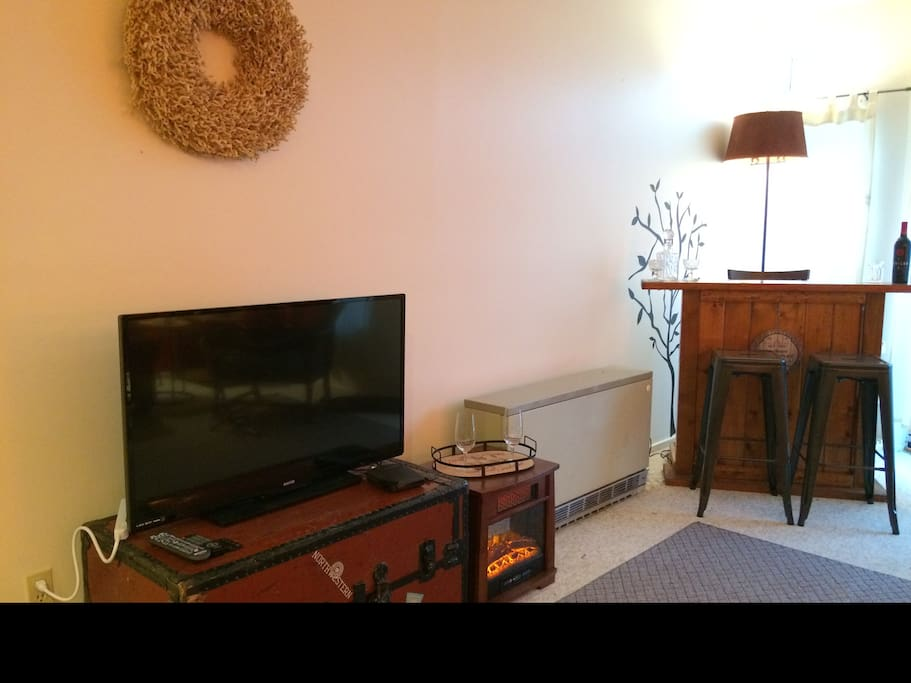 Flatscreen TV with Cable & the bar.