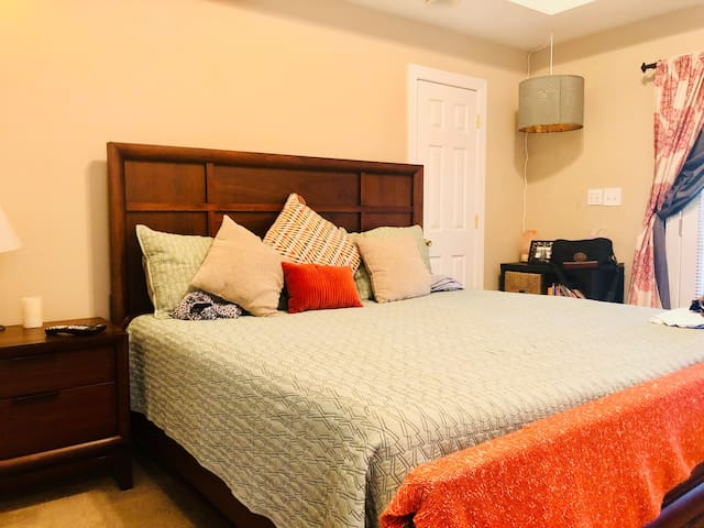 Main bedroom with super comfy & new tempurpedic king size mattress, TV, and private porch.