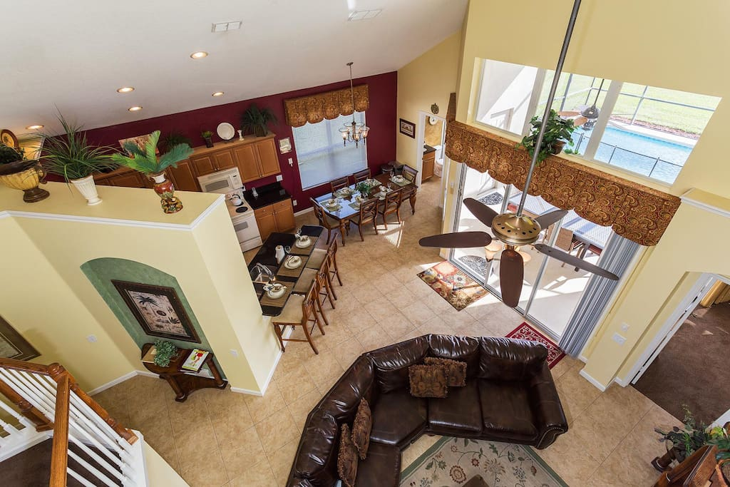 Spacious living area with easy access to the lanai and screened in pool