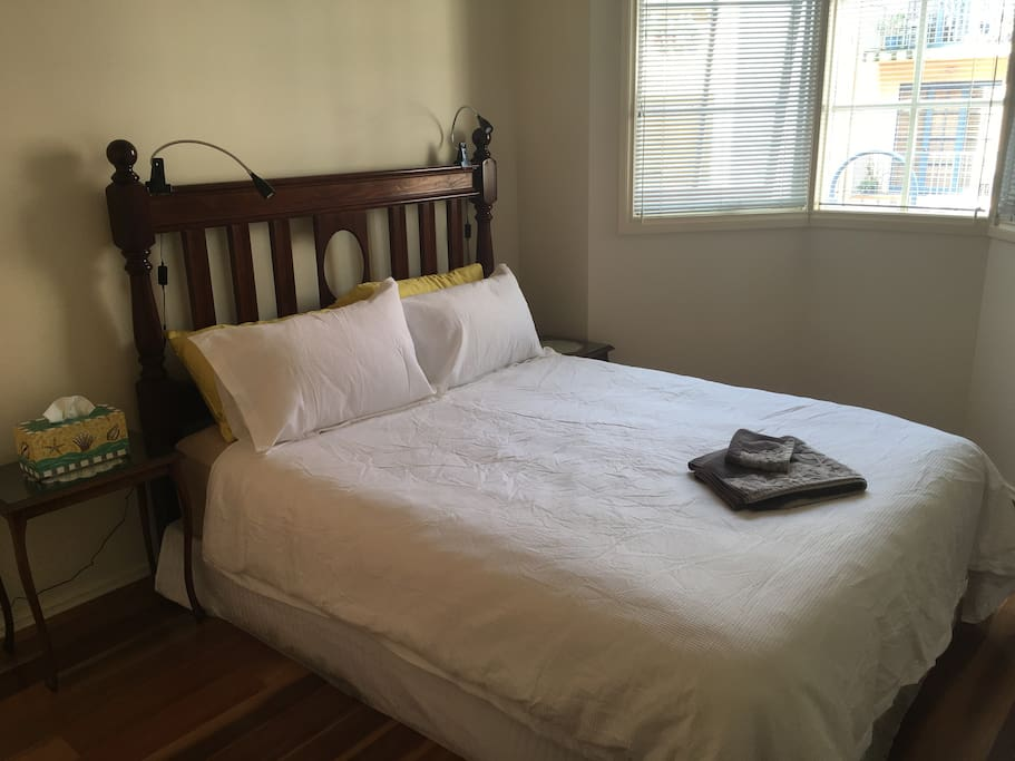 Master bedroom - queen size bed with bay window overlooking the courtyard