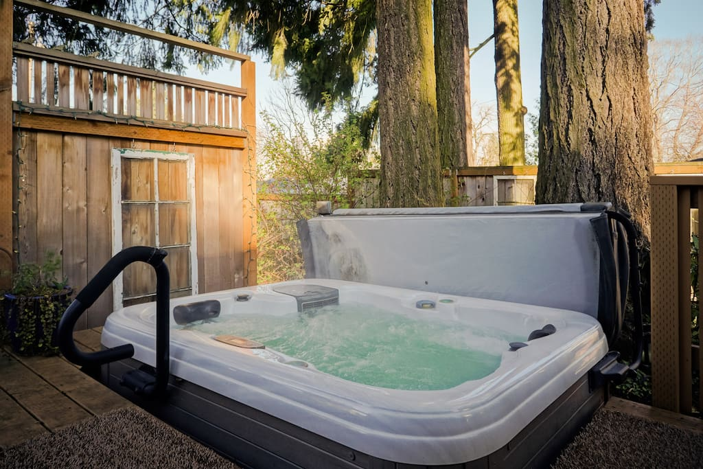 The hot tub under tall firs is available