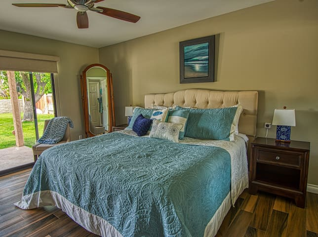The master bedroom has  its own access to the backyard, pool and spa.