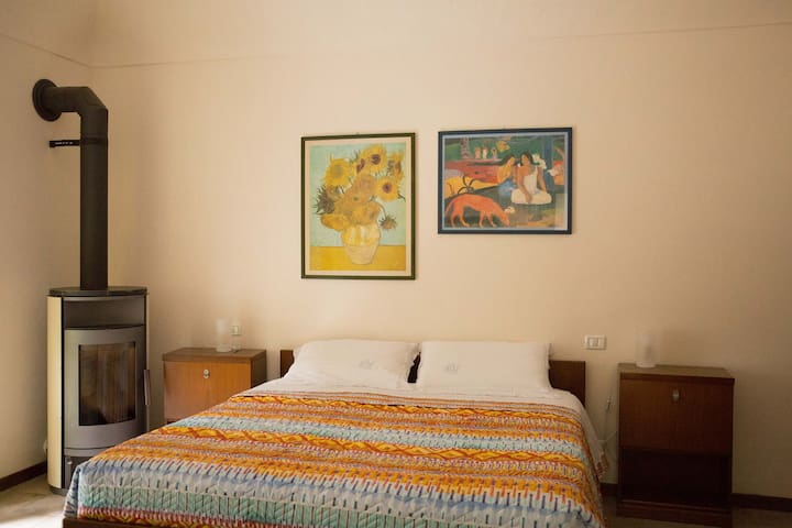 Double room with king size bed and pellet stove
