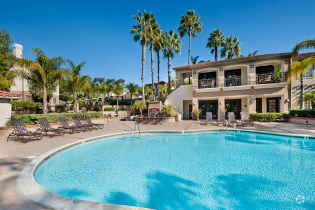 Development, Torrey Villas, has two swimming pools and a hot tub , fitness center , club house