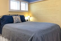The Poetry Room. A quiet corner room at the back of the house with a queen bed, desk, and closet space. Hand-painted mural of a Victor Hugo poem in French. We'll give you an English translation!