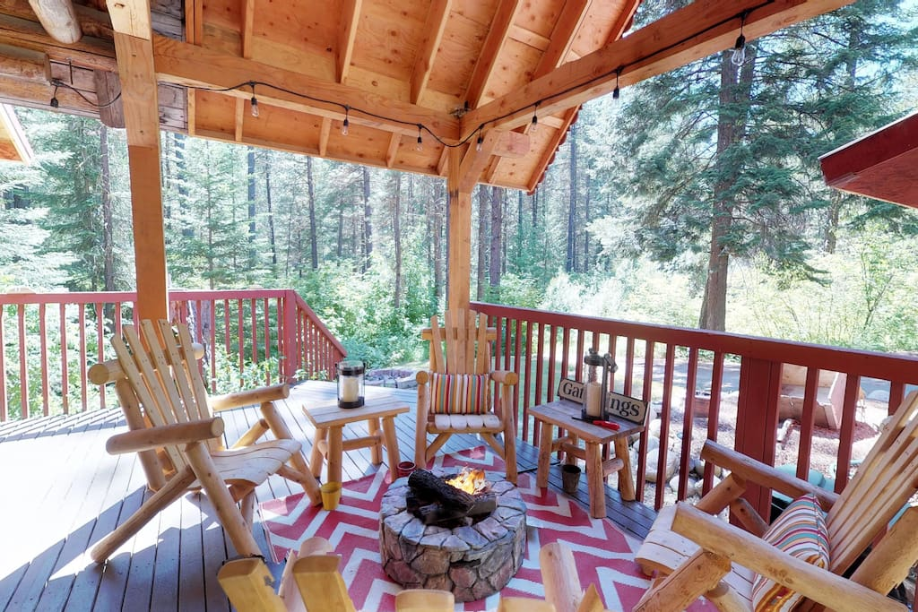 Covered outdoor living space with propane firepit and lots of seating  for your pleasure