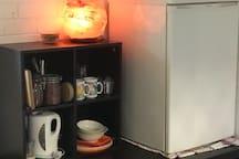 Bar fridge, kettle & toaster.  Tea, coffee, sugar & granola are all provided.