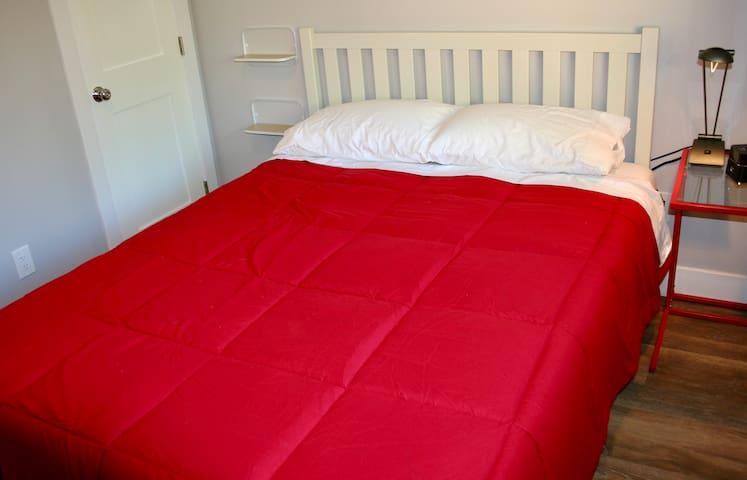 Bedroom has a queen-size bed.