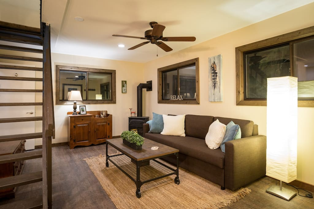 Living room with pull out couch to sleep two guests