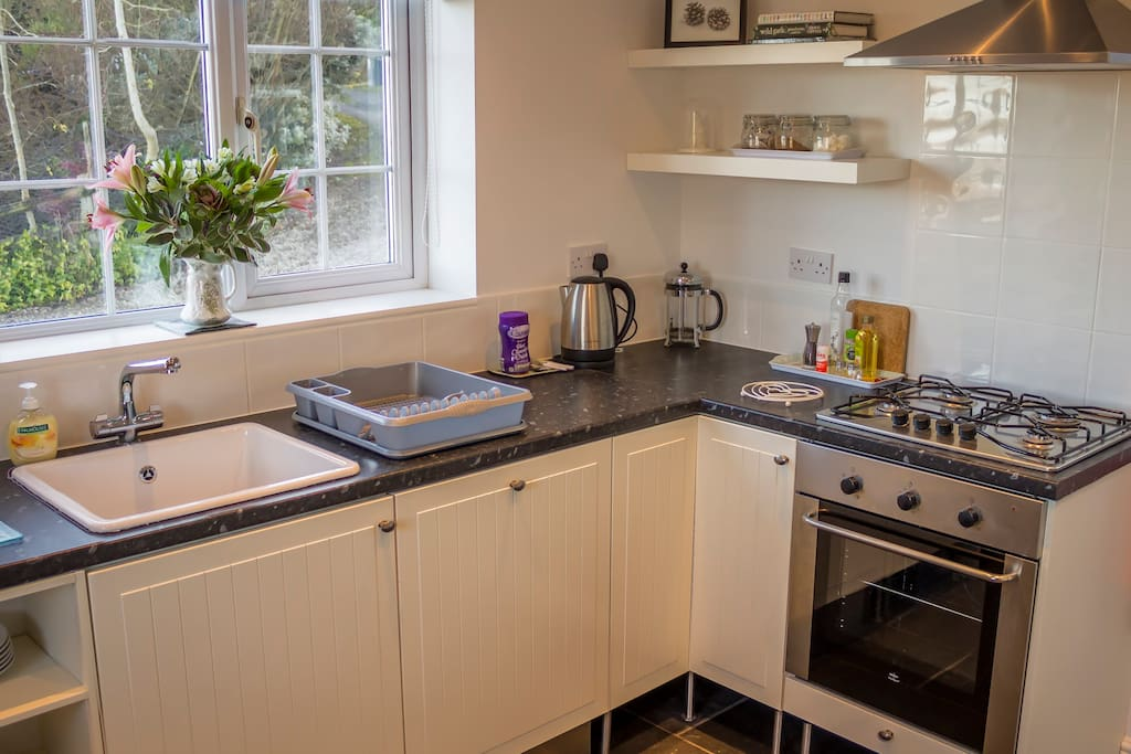 The kitchen at Hillside includes an integrated dishwasher, gas hob/electric oven and microwave.