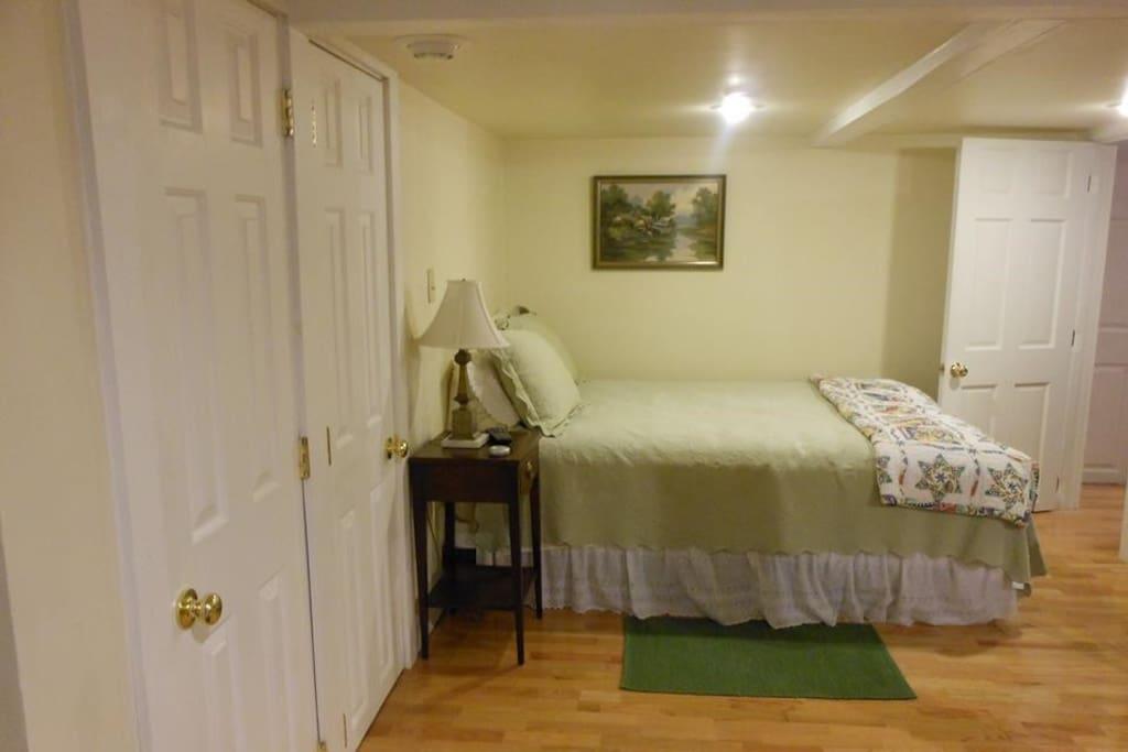 Cozy queen bed room.